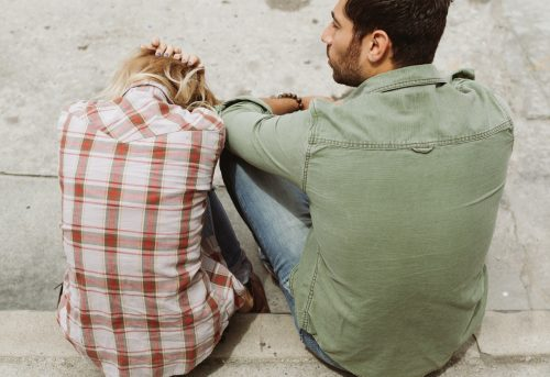 A couple discussing relationship issues, a frequent reason why people would go to online therapy. Talking to a professional through online therapy could clear a lot of things between a couple.