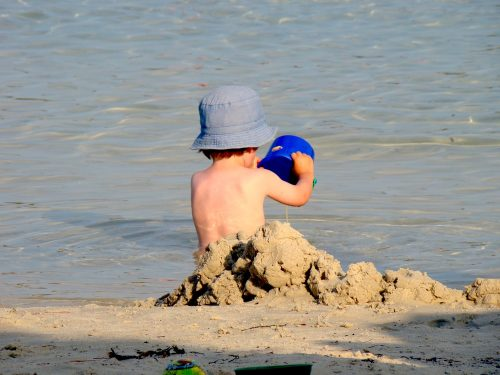 A child playing on the beach is a similar scenario in sand tray therapy.. This therapy allows a healthcare provider to get to know a child. Playing therapy is appropriate for children aged 3 to 12 years old.